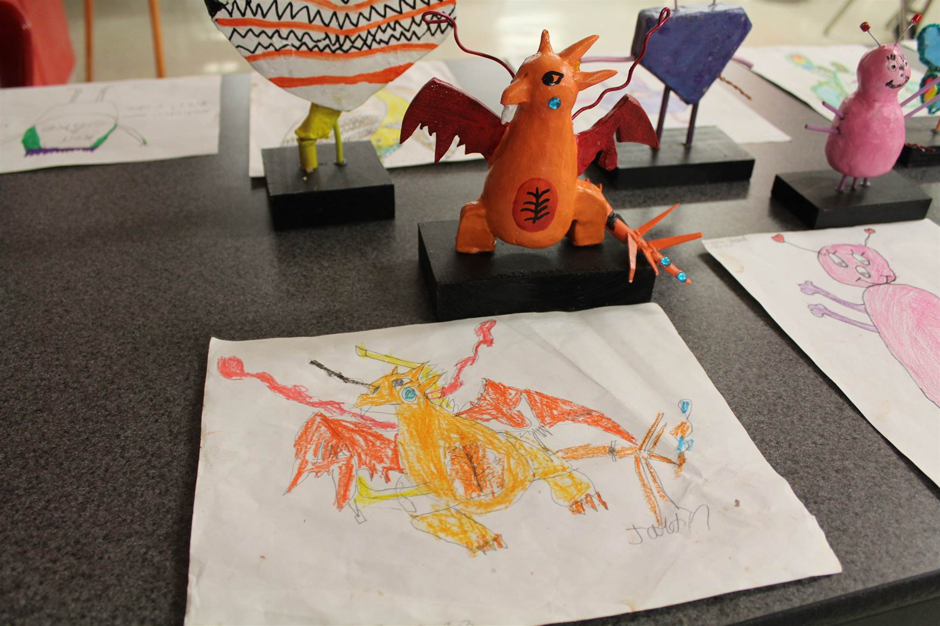 monster 3 d sculpture next to drawn picture 51