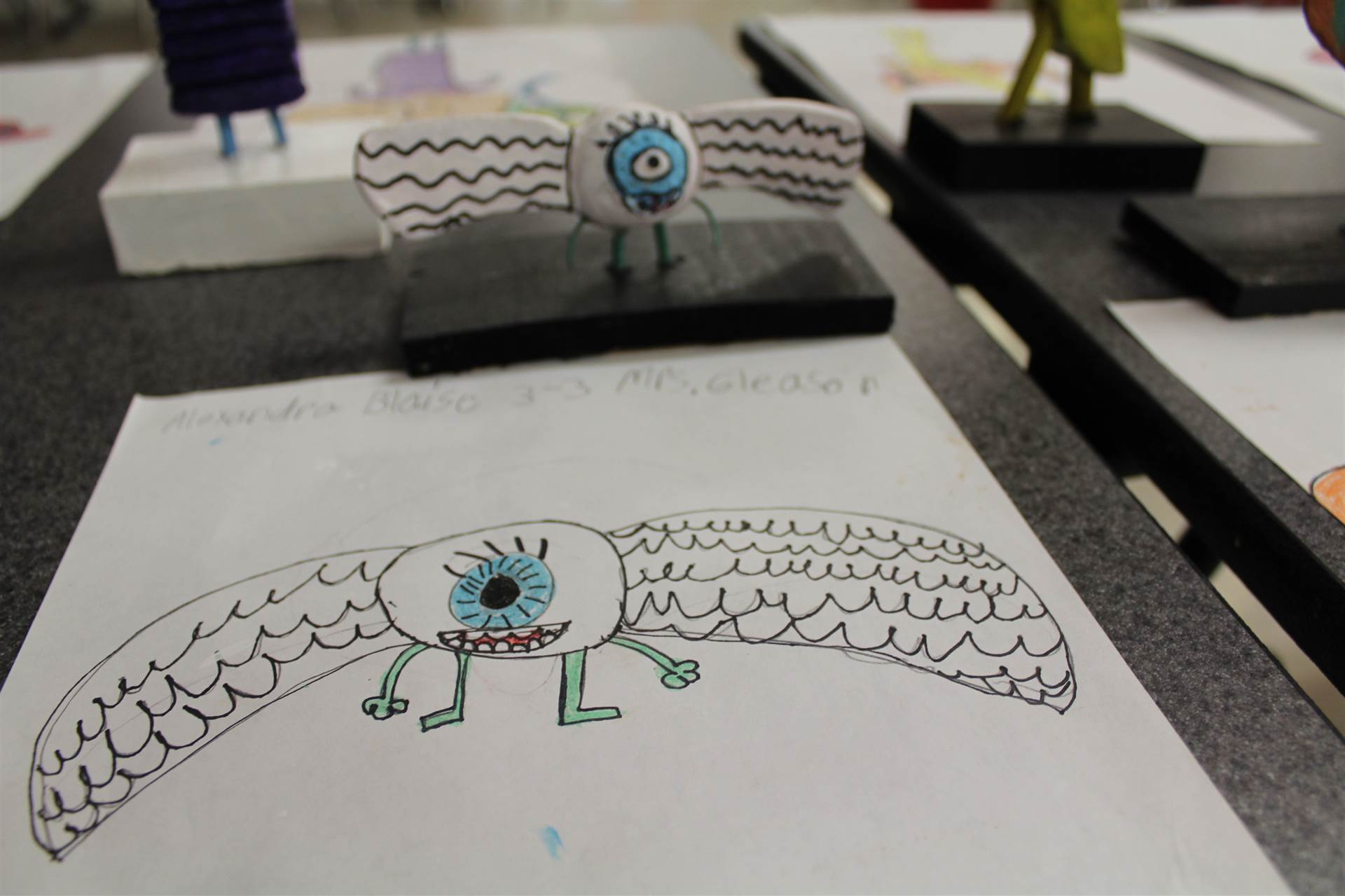 monster 3 d sculpture next to drawn picture 47
