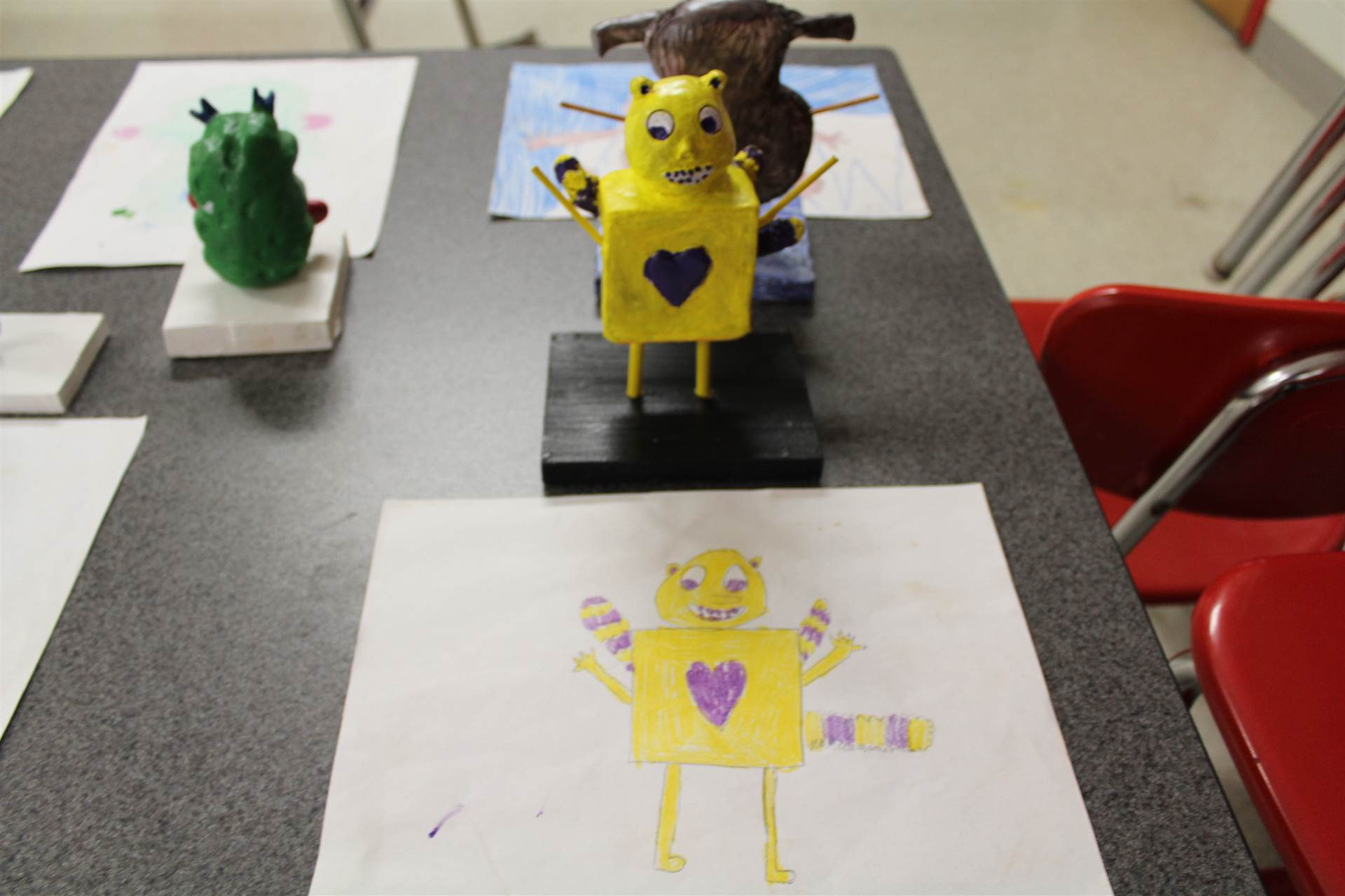 monster 3 d sculpture next to drawn picture 39