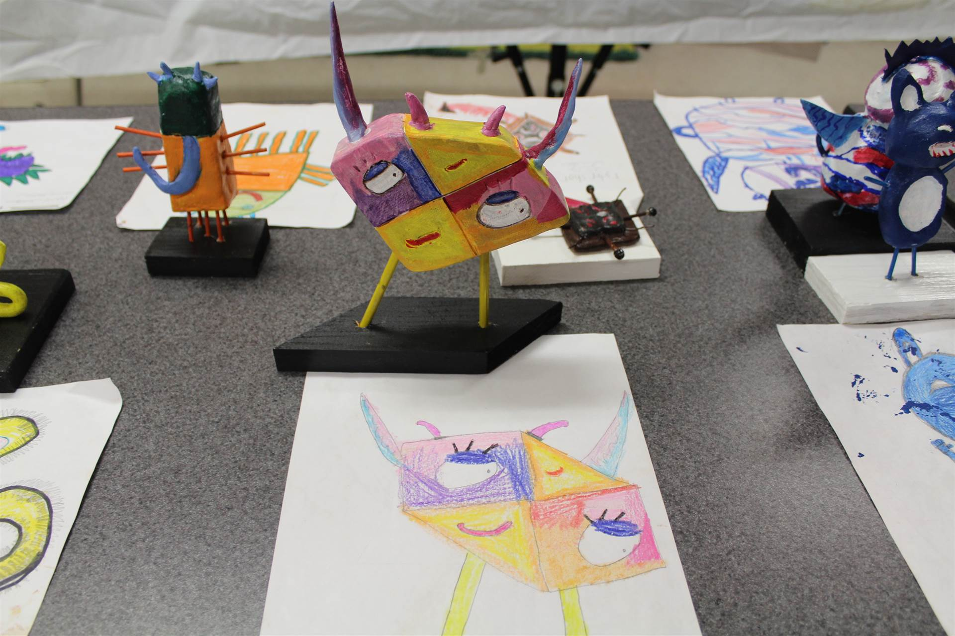 monster 3 d sculpture next to drawn picture 33