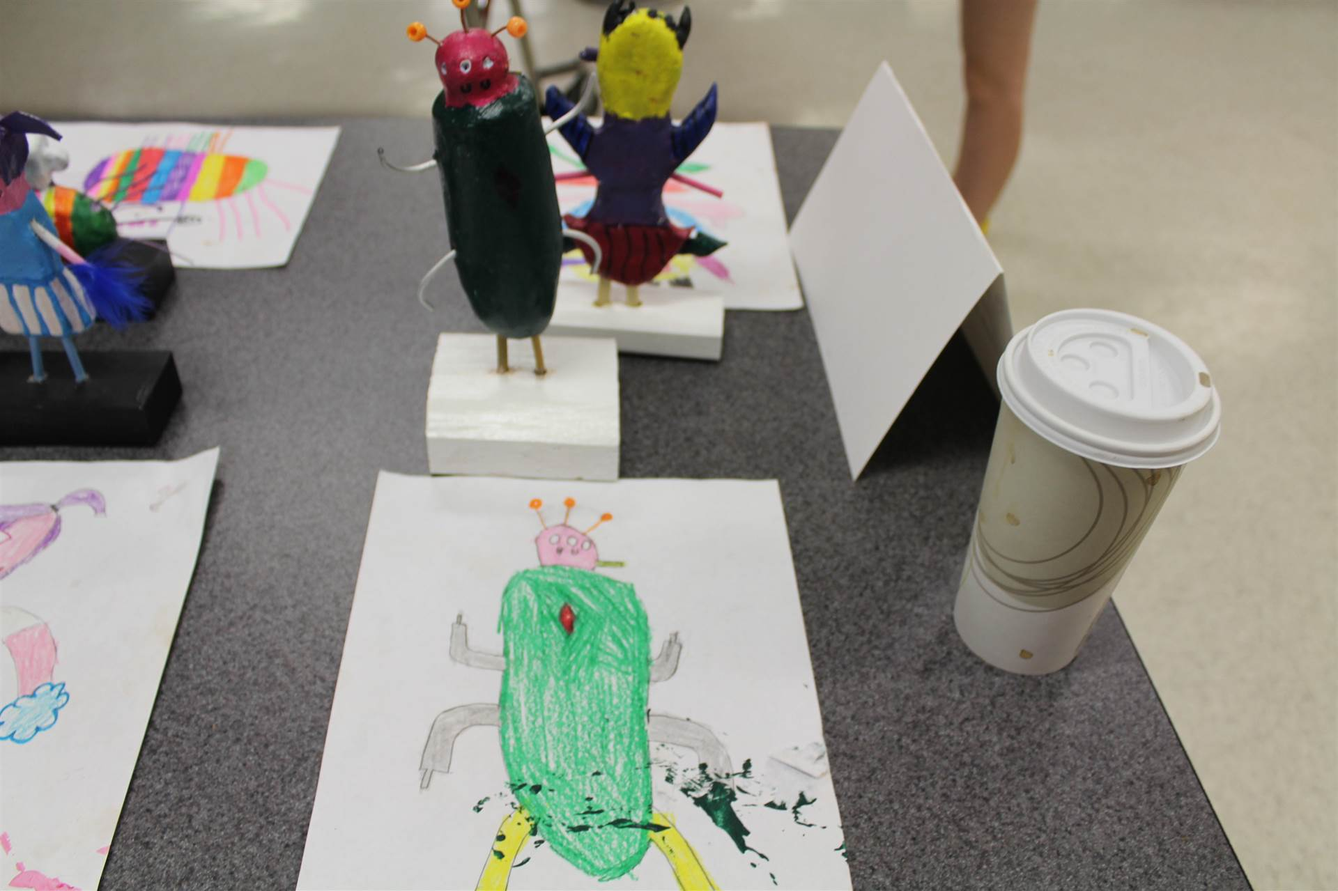 monster 3 d sculpture next to drawn picture 29