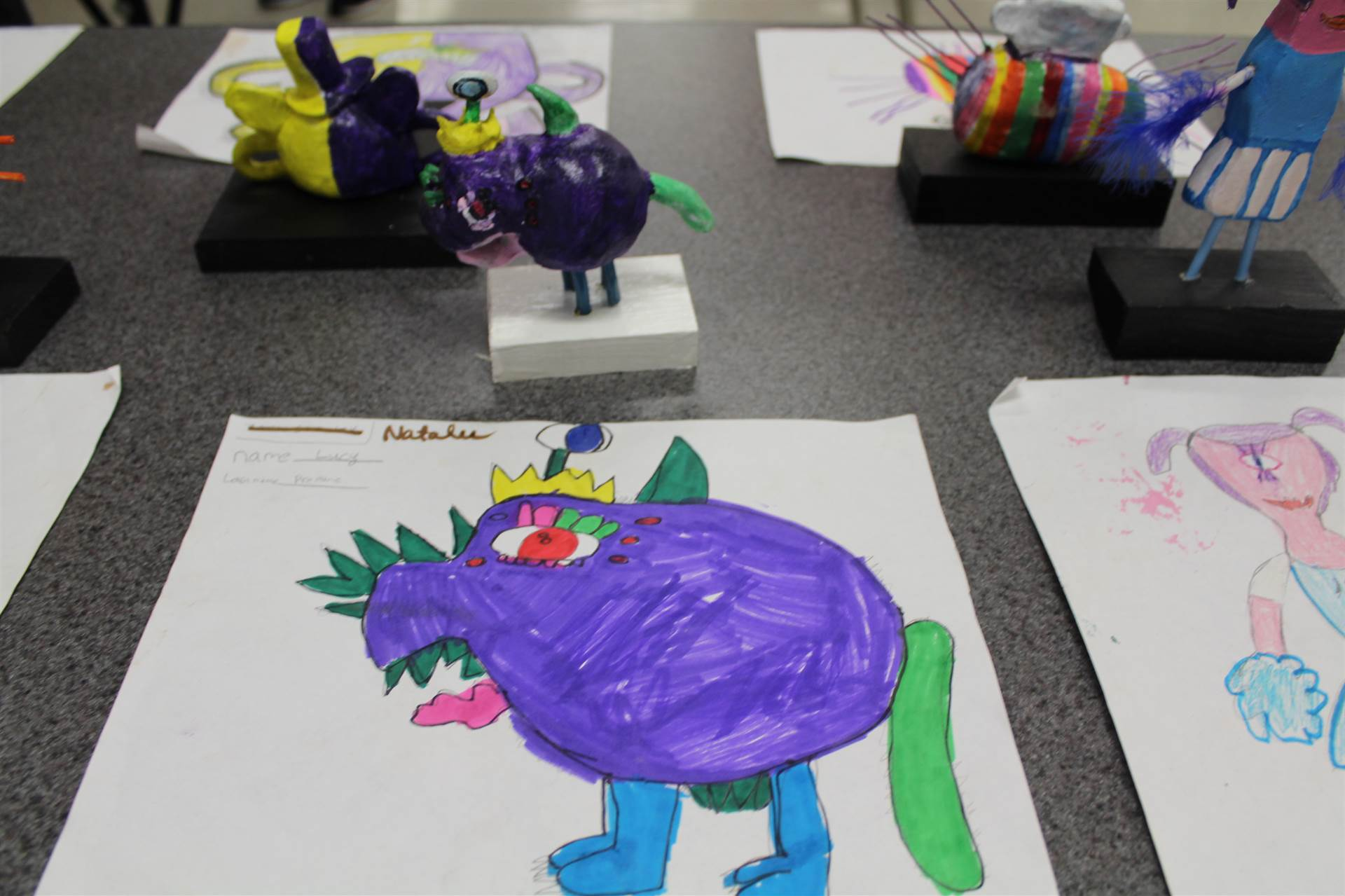 monster 3 d sculpture next to drawn picture 27
