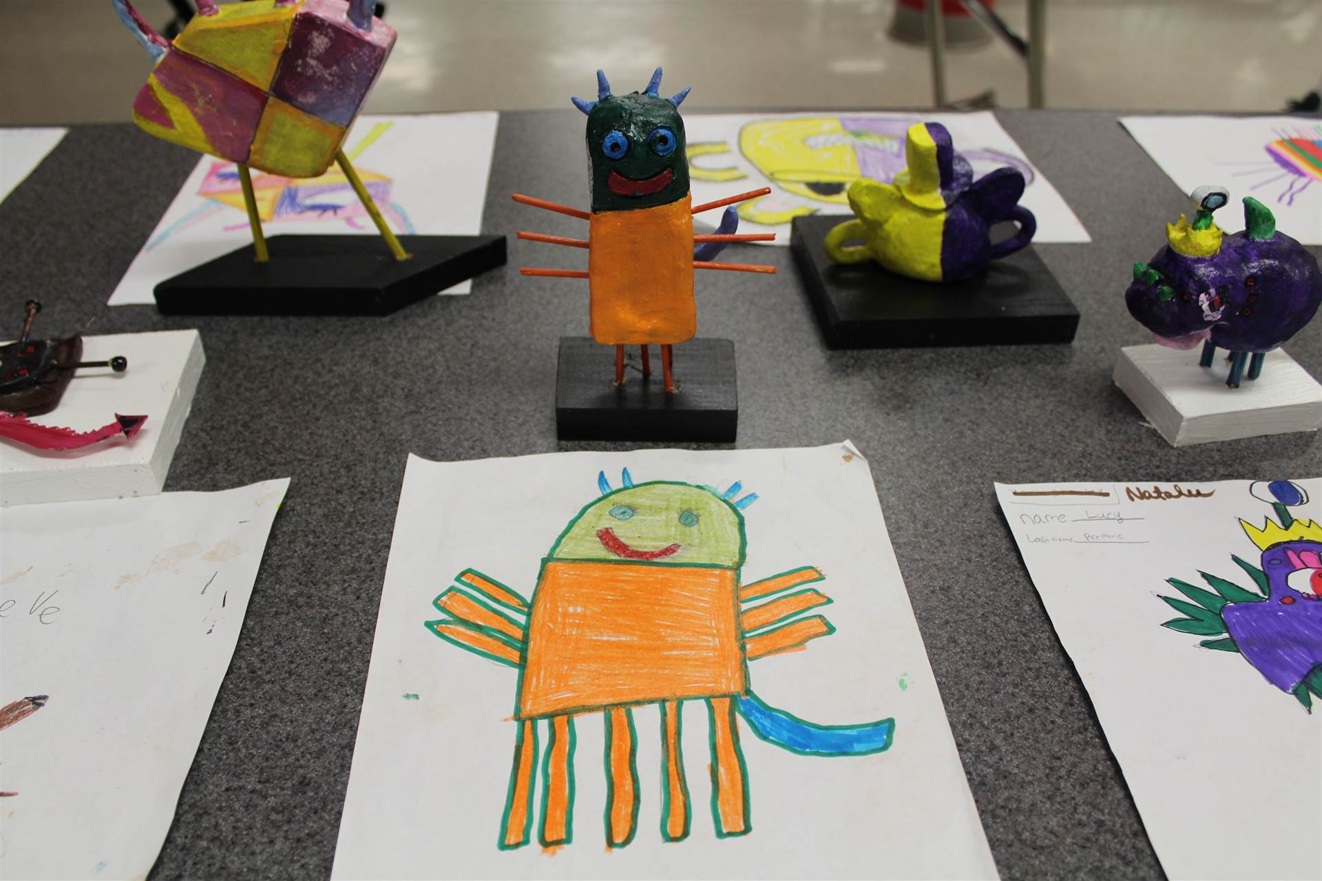 monster 3 d sculpture next to drawn picture 26