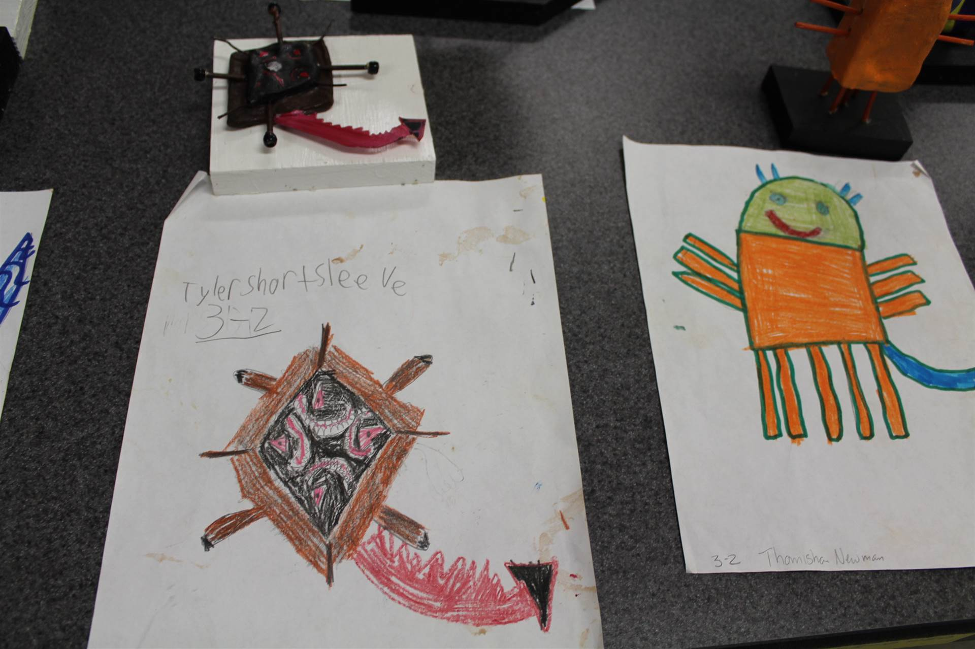 monster 3 d sculpture next to drawn picture 25