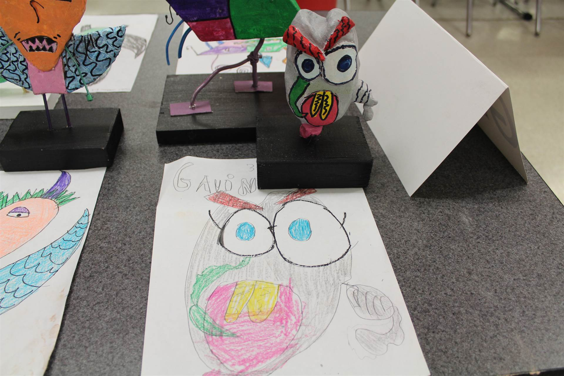 monster 3 d sculpture next to drawn picture 41