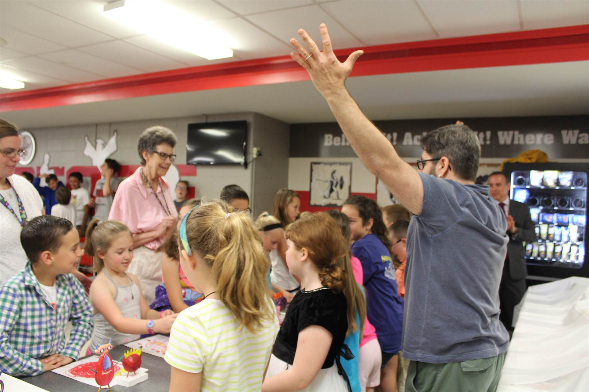 mr fitzsimmons talks to students with their new 3 d monster sculptures