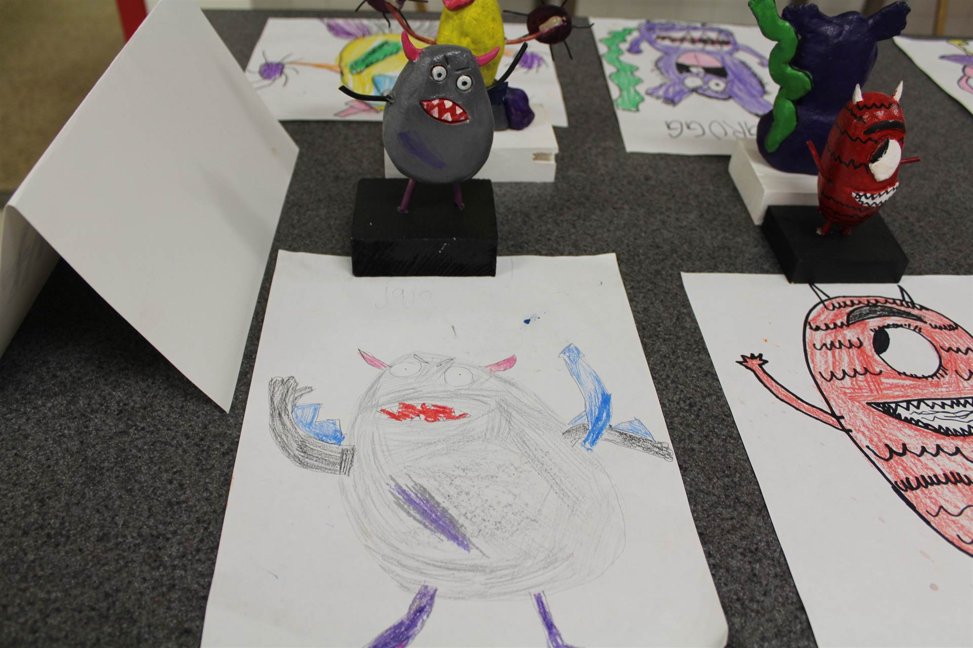 monster 3 d sculpture next to drawn picture 126