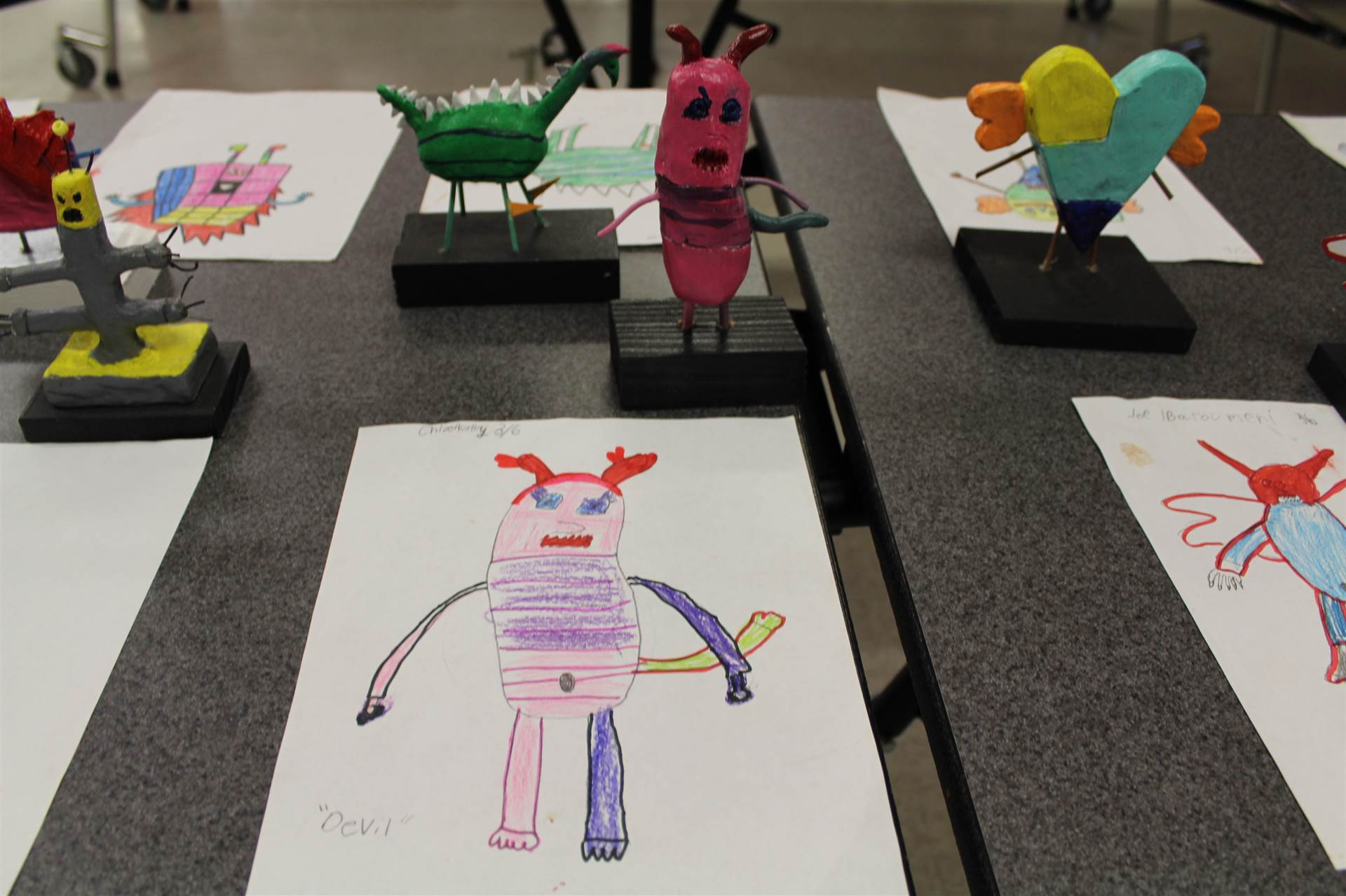 monster 3 d sculpture next to drawn picture 119