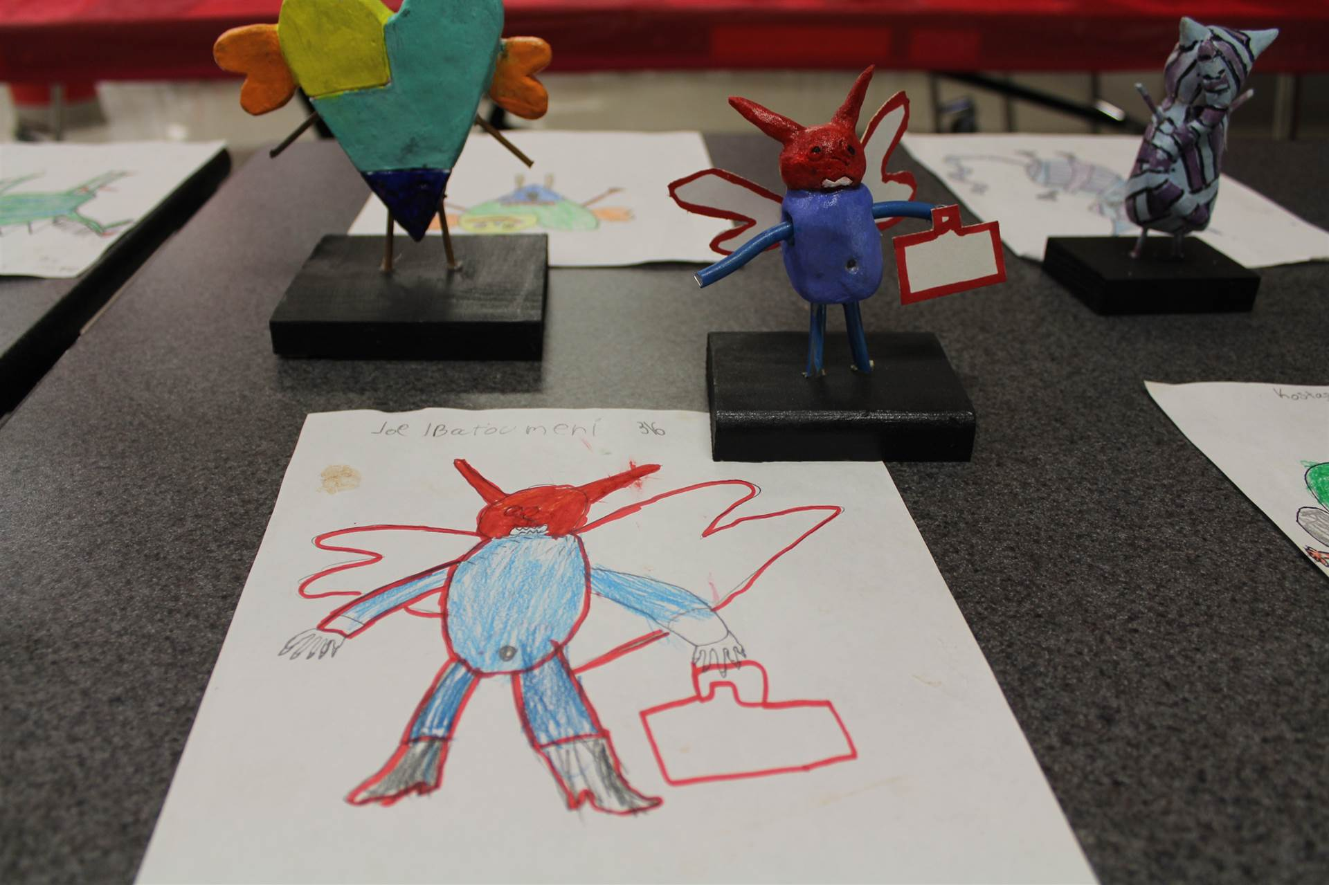 monster 3 d sculpture next to drawn picture 118