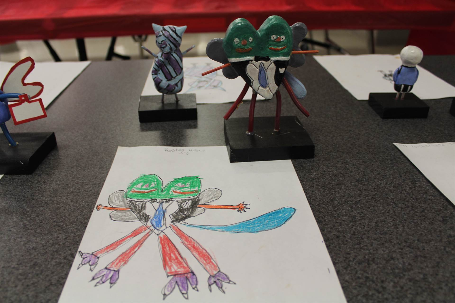 monster 3 d sculpture next to drawn picture 117