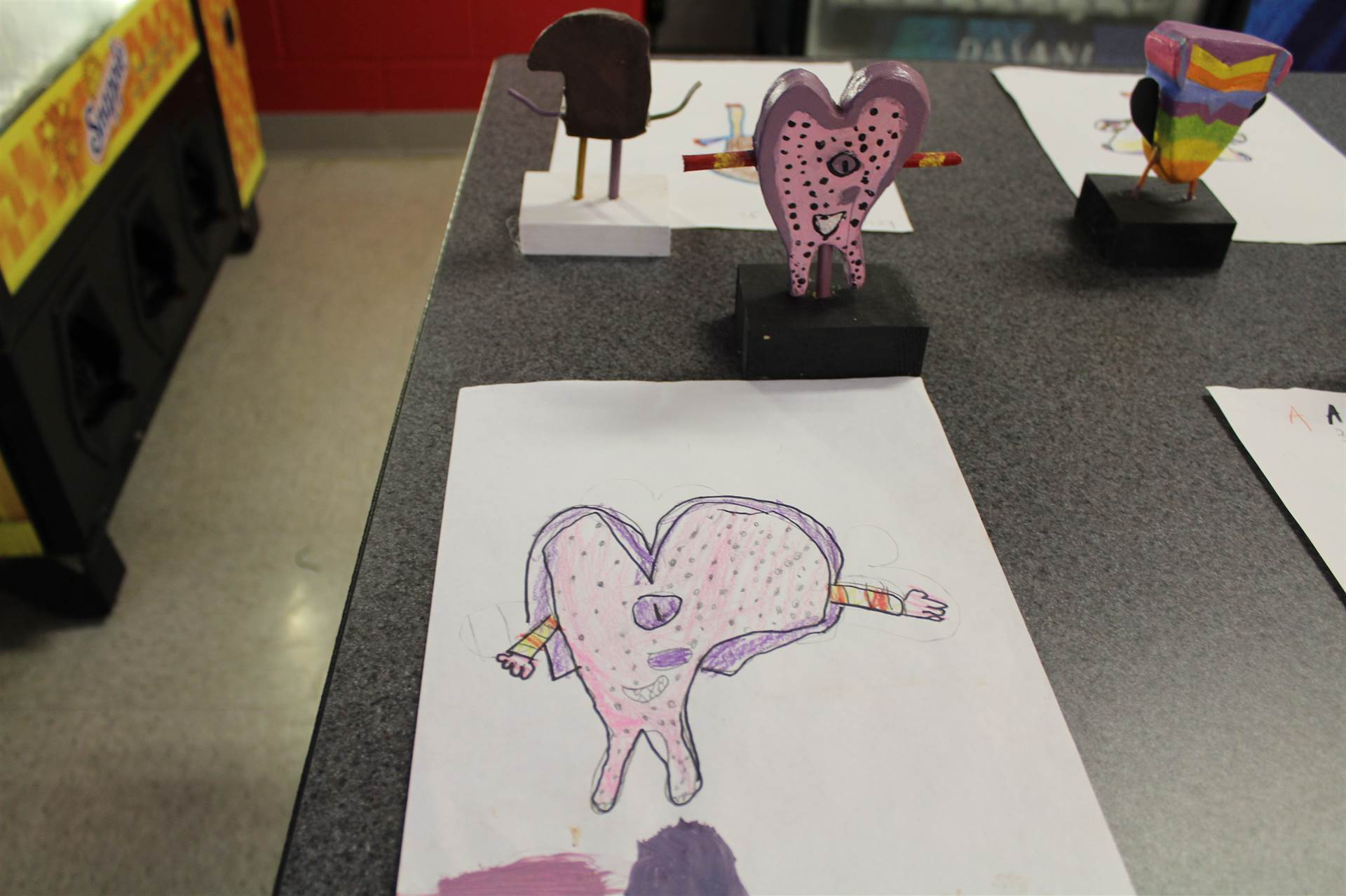 monster 3 d sculpture next to drawn picture 113