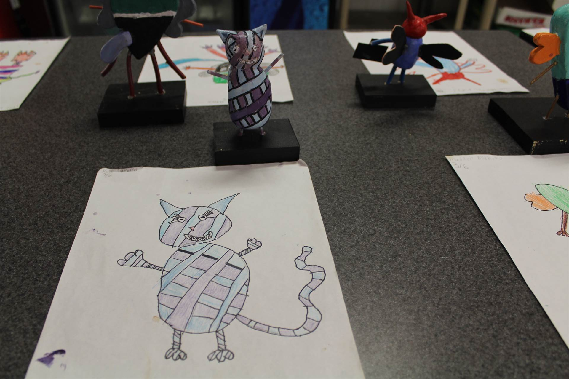 monster 3 d sculpture next to drawn picture 110