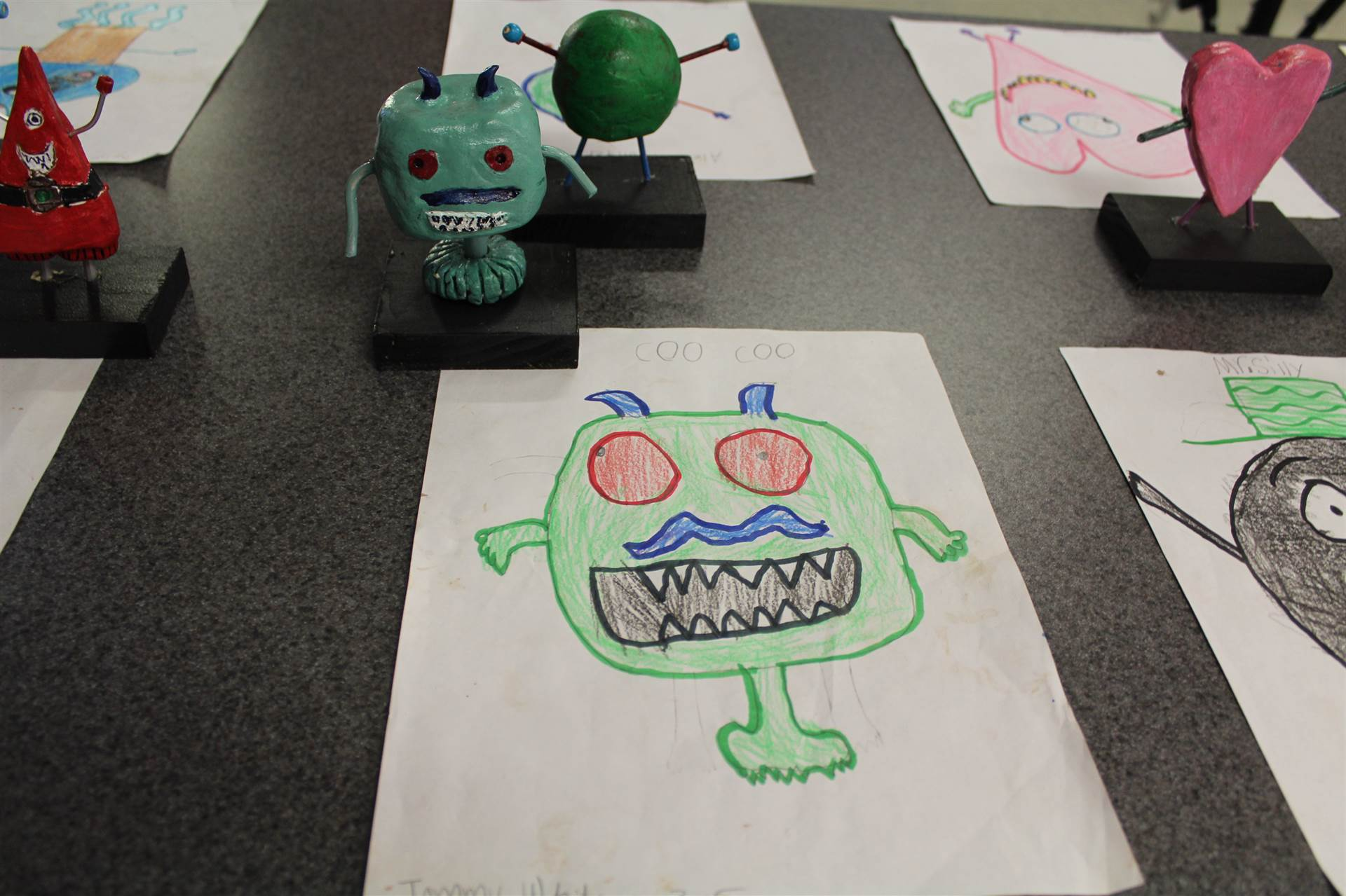 monster 3 d sculpture next to drawn picture 94