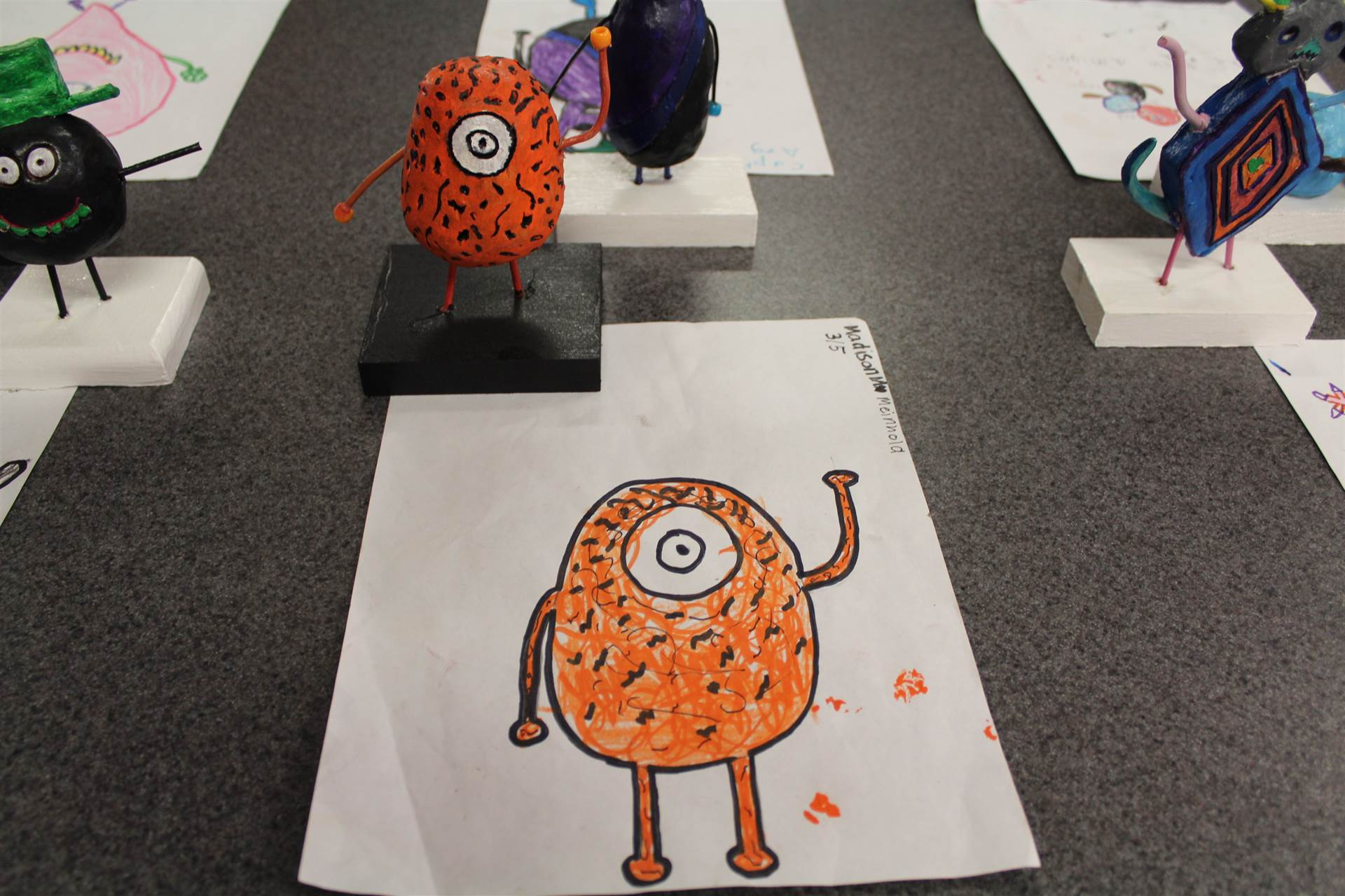 monster 3 d sculpture next to drawn picture 92