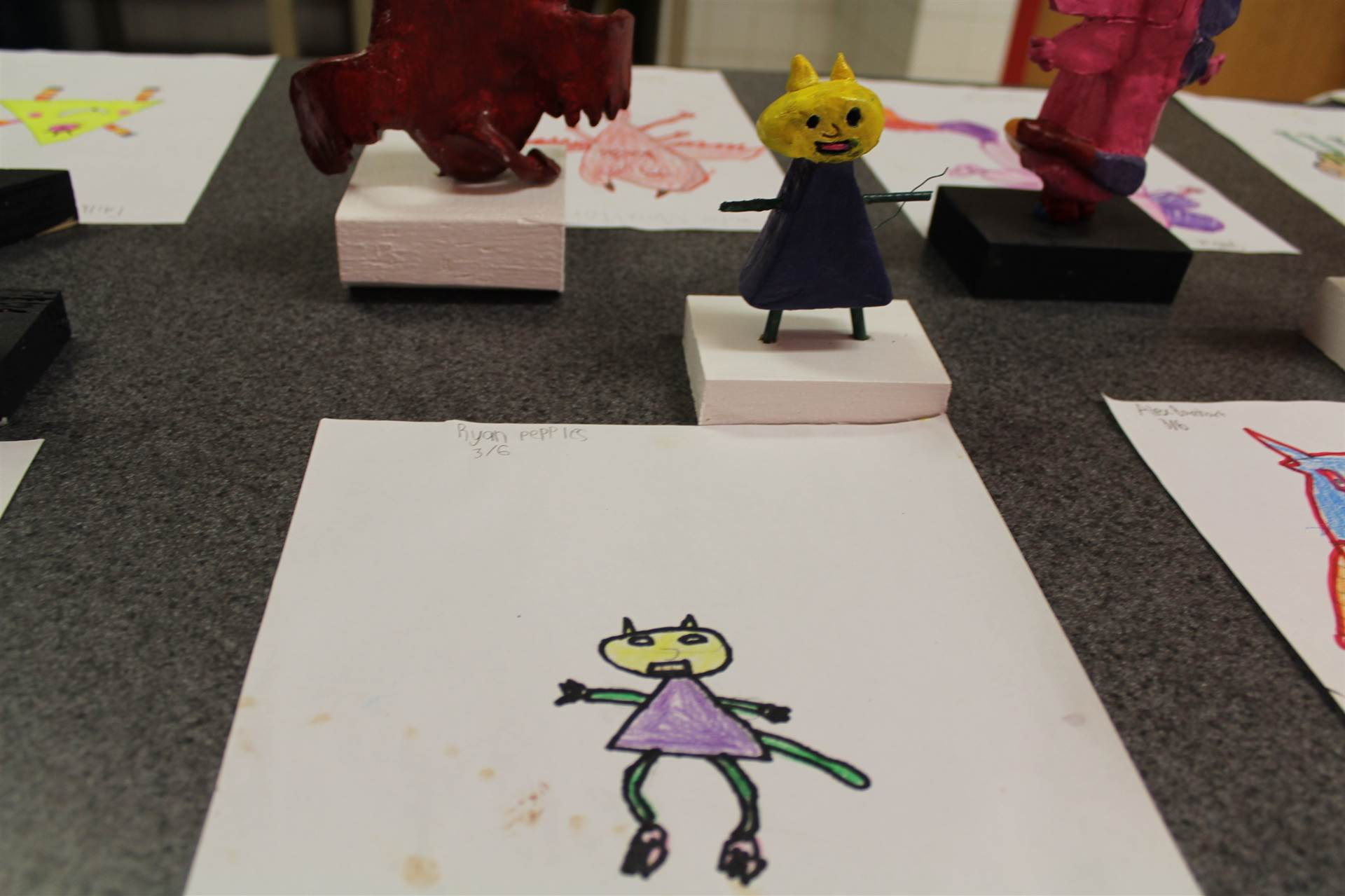 monster 3 d sculpture next to drawn picture 105