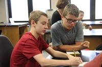students work together on equation