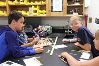 students build bridges made of popsicle sticks at boces summer steam academy