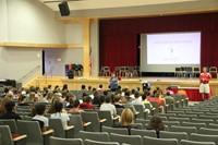 mrs latimer talking to students at freshman orientation