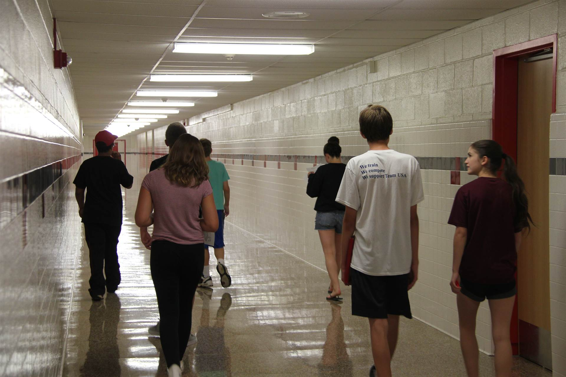 group of students walking down hall at freshman orientation