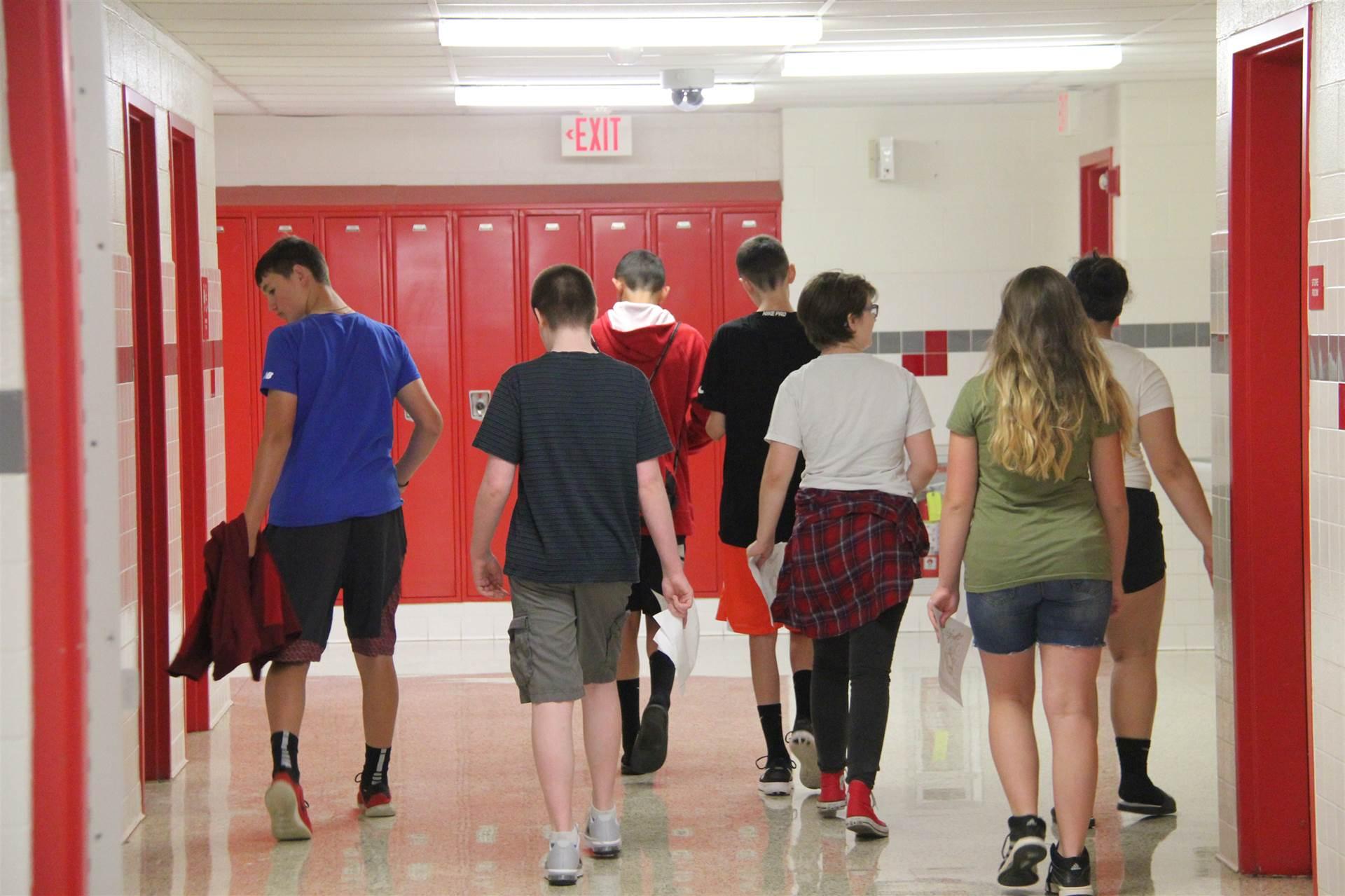 students walking down hallway at freshman orientation