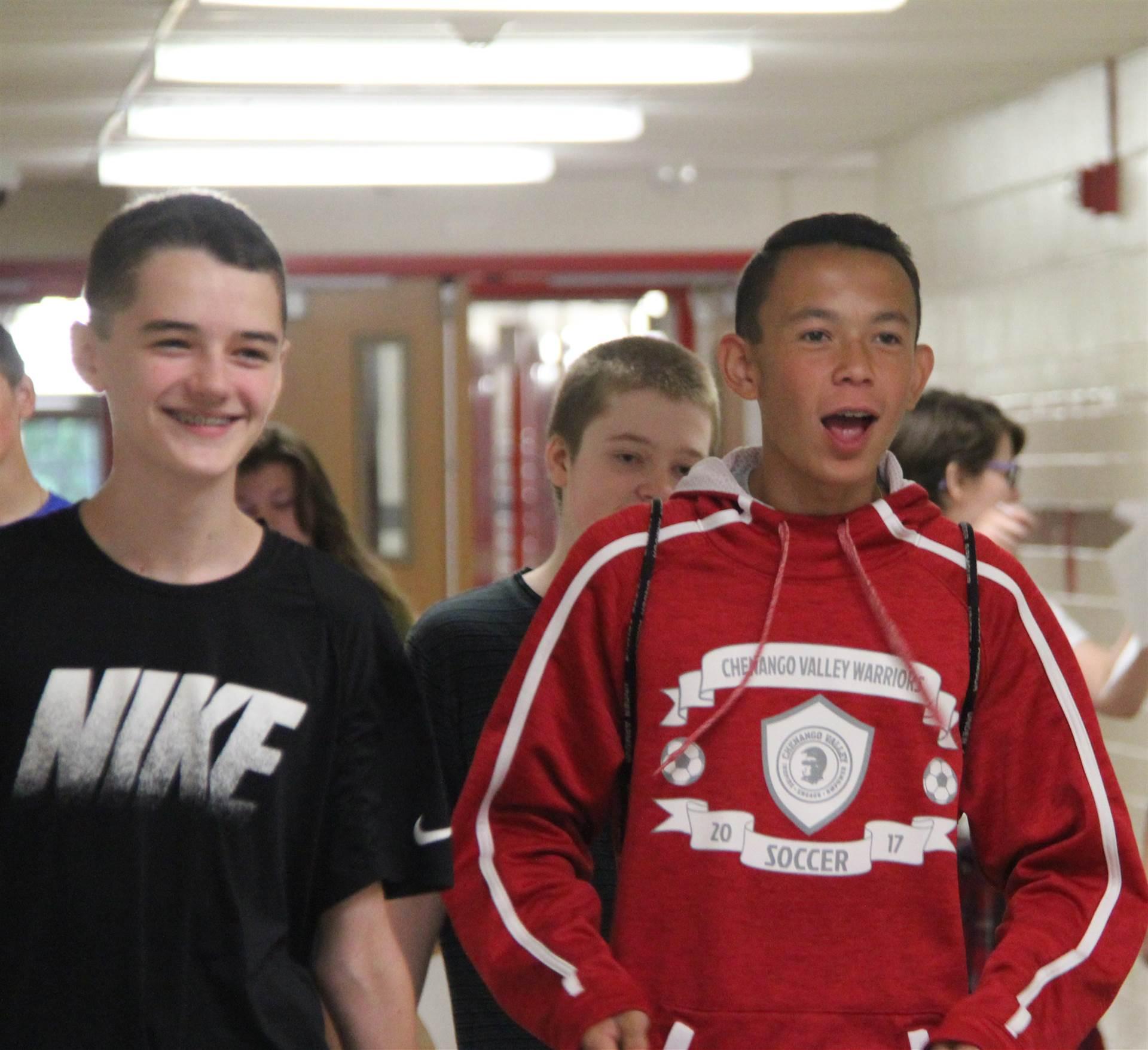 students walking down high school hallways