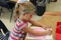student coloring at port dickinson elementarys kindergarten orientation