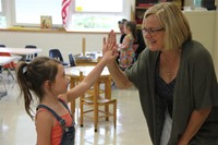 incoming kindergarten student and her new teacher high five at port dickinson elementary kindergarte