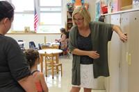 incoming kindergarten student gets her new cubby at port dickinson elementary kindergarten orientati