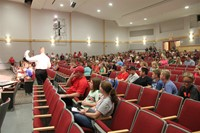 principal attleson speaks with seventh and eighth graders and their parents and guardians about upco
