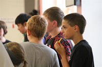 group of male students talking at middle school orientation