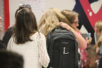 students hug when they see each other at middle school orientation