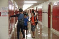 student finds his new locker at middle school orientation