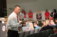 closer shot of principal attleson speaking with sixth grade students parents and guardians in audito