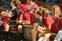students listening to principal attleson speak at middle school orientation