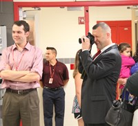 principal attleson takes photos at middle school orientation