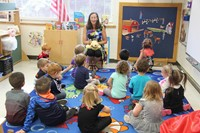 pre k class learns about manners while sitting on rug in classroom on first day