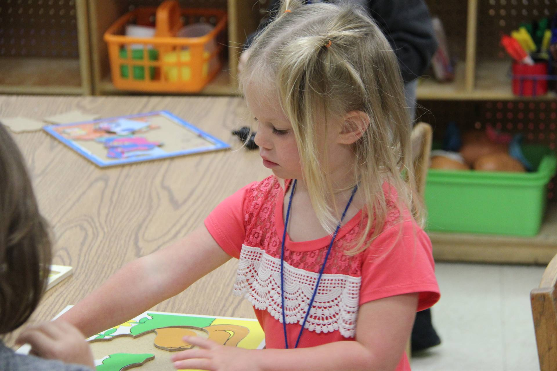 pre k student works on puzzle
