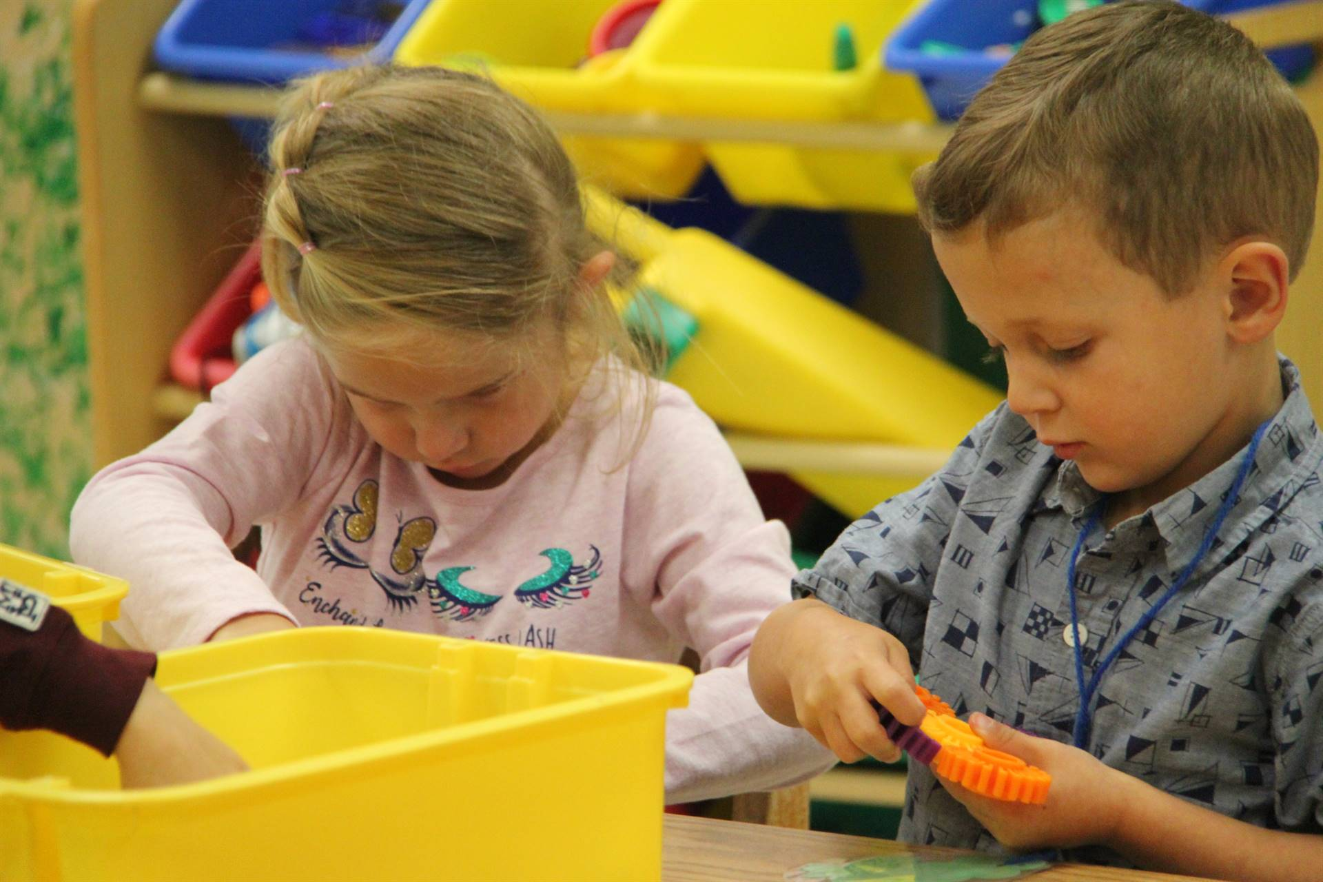 two pre k students build with connectors on first day