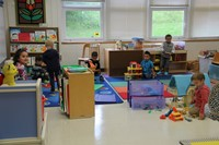 wide shot of pre k students playing in their classroom on first day