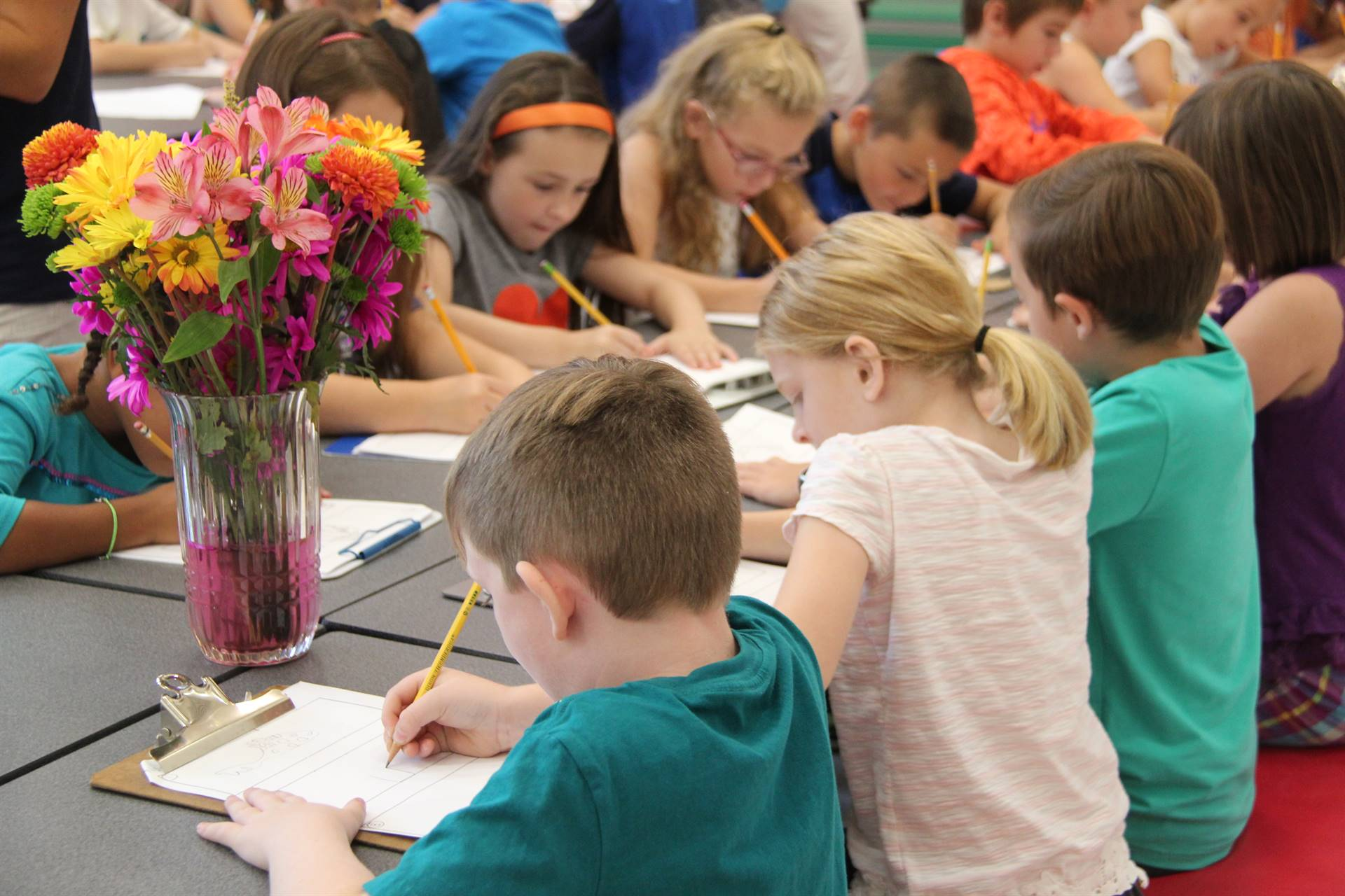 students sketch flowers