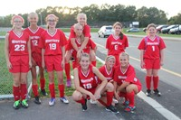 members of j v girls soccer team smiles for a picture after their game