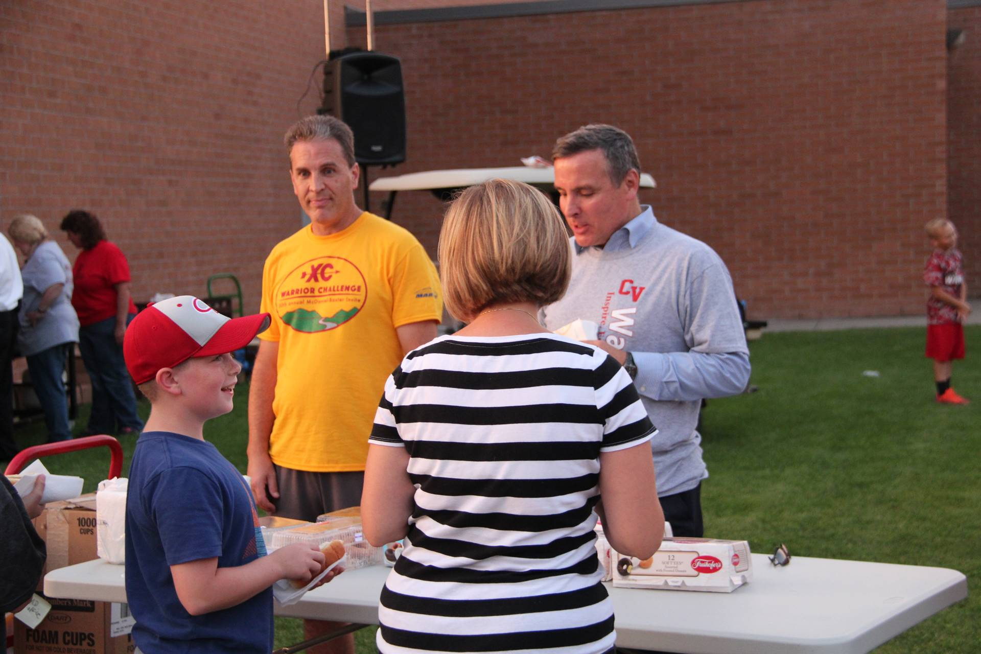 superintendent gill helps serve food to members of the community at rally in the valley event