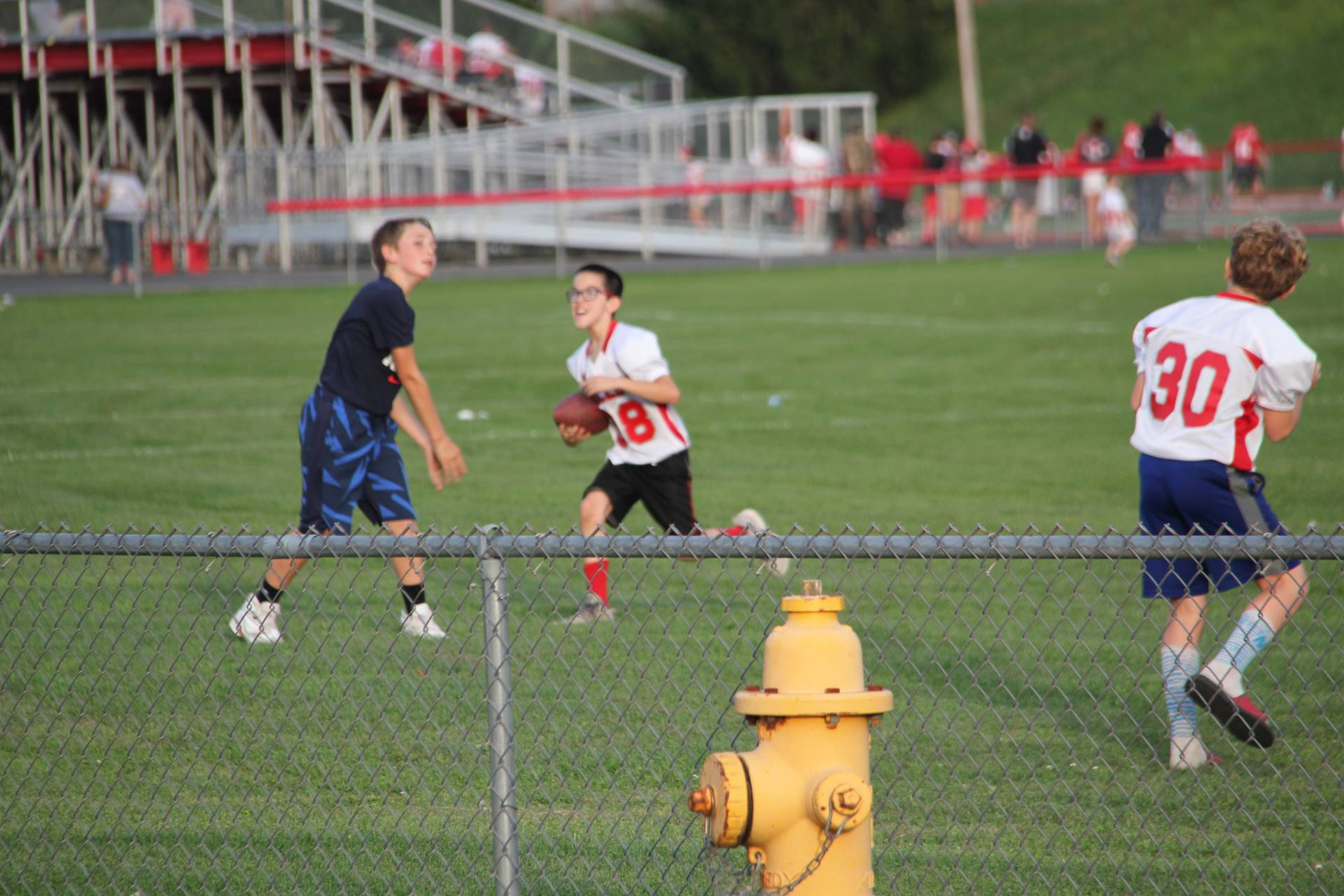 boys playing football next to c v stadium