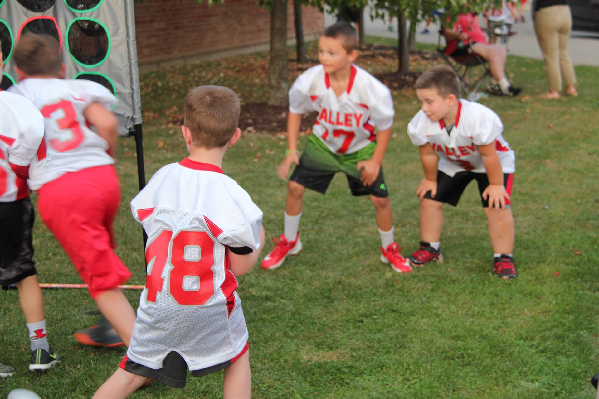 young students play with football game at rally in the valley event