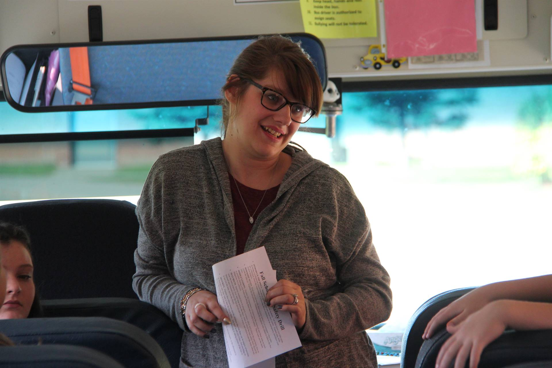 bus driver amanda wiley talks to students during bus drill