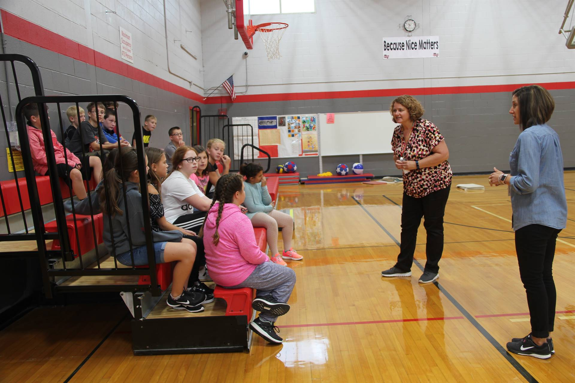 guidance counselors talk to middle school students in middle school gymnasium