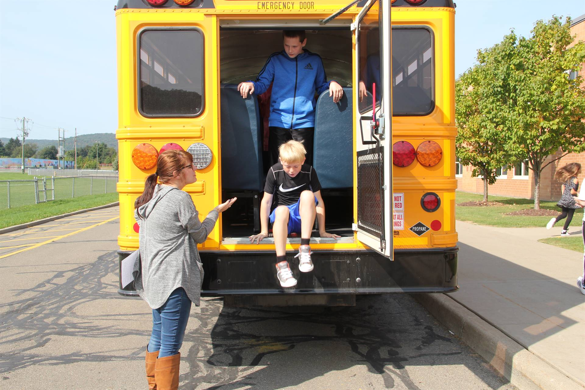 middle school student exits back of bus for bus drill