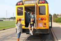 middle school student exits from the back of the bus for bus drill