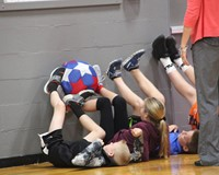 middle school students work on team building exercise
