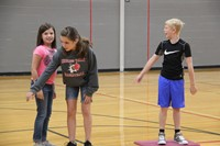 middle school students play a game of lava